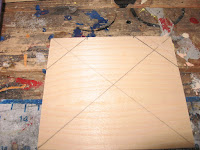 There should be 2 small triangles marked out at the top of the plywood.