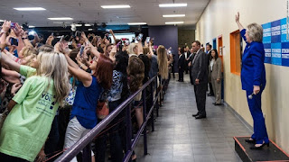 Hilary Clinton with crowd taking selfies