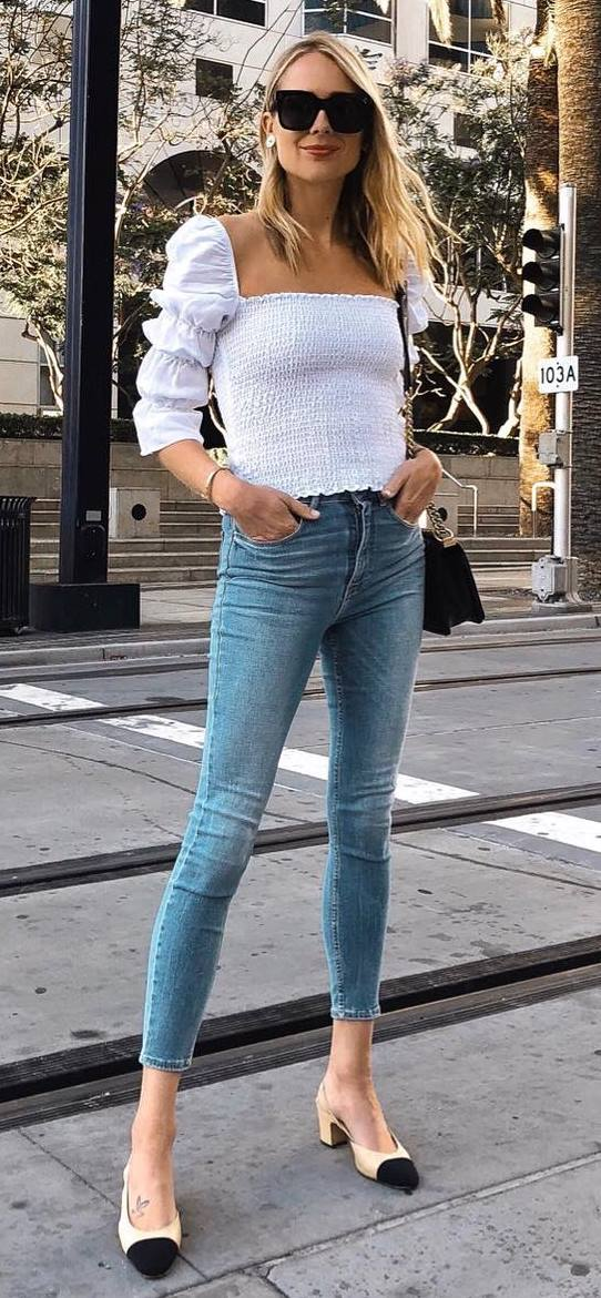 what to wear with a pair of skinny jeans : white ruffle top + bag + heels