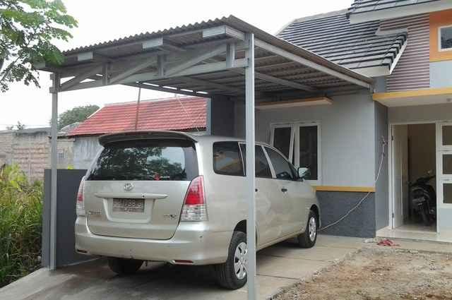 Desain rumah bergarasi