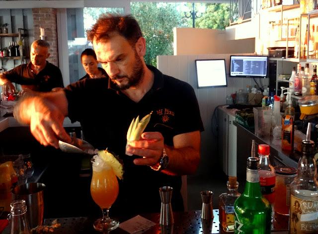 Bartender concocting cocktails - Rachi Taverna Lefkada