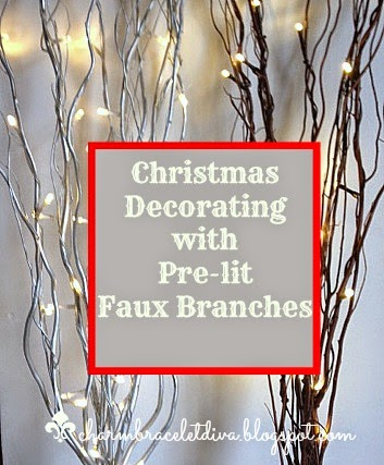 silver and brown faux branches with lights