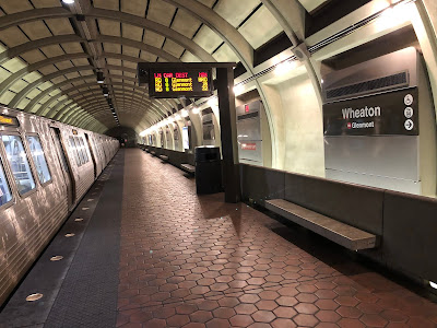 Photo of a Metro train platform with a Wheaton sign and a train stopped