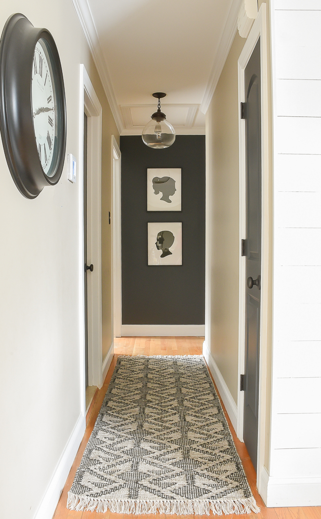 High contrast hallway with silhouette art