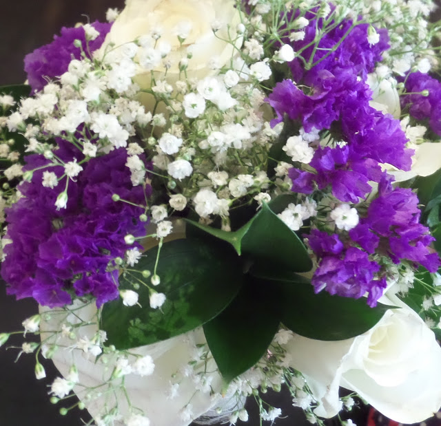 purple statice and baby's breath bouquet
