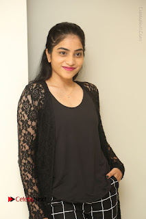 Actress Punarnavi Bhupalam Stills in Black Dress at Pittagoda Press Meet  0025.JPG