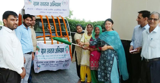 Additional Deputy Commissioner, Anjum Chaudhari has shown green chariot under the village Swaraj campaign