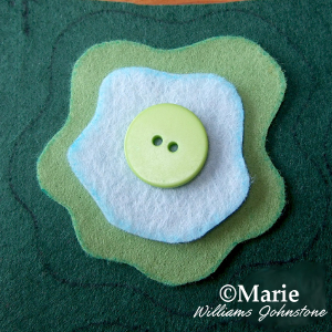 Green trio of felt fabric and button detailing