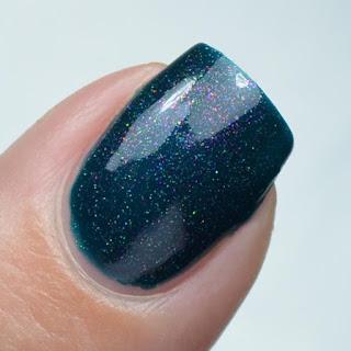 teal nail polish with shifting flakies