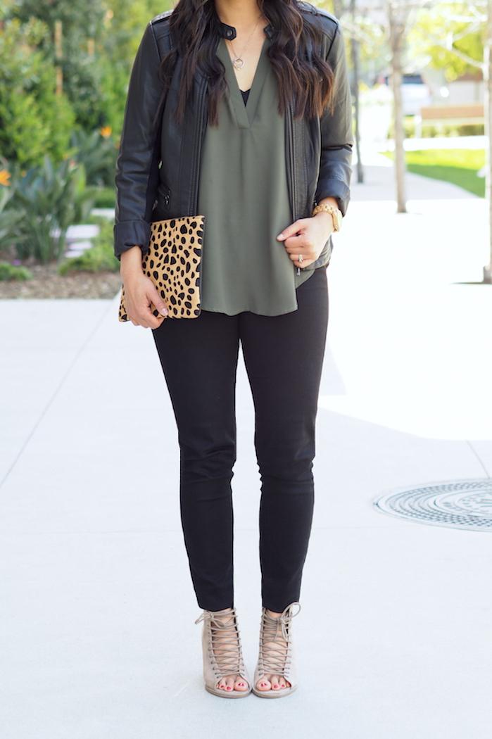 olive top + black leather jacket + leopard clutch + strappy heels