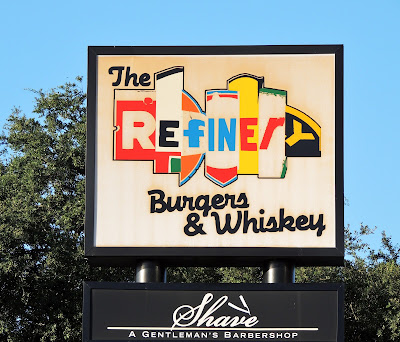 The Refinery Burgers & Whiskey (signage) Shave Barbershop (sign)