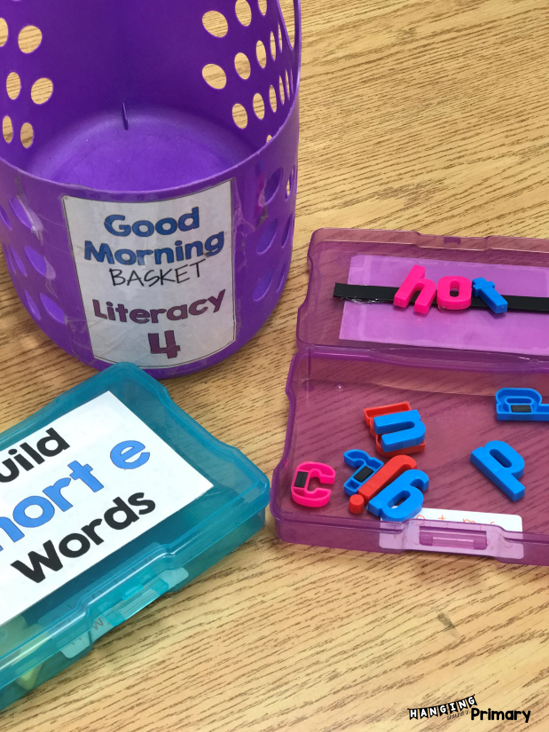 create word building boxes with magnets and magnetic tape.