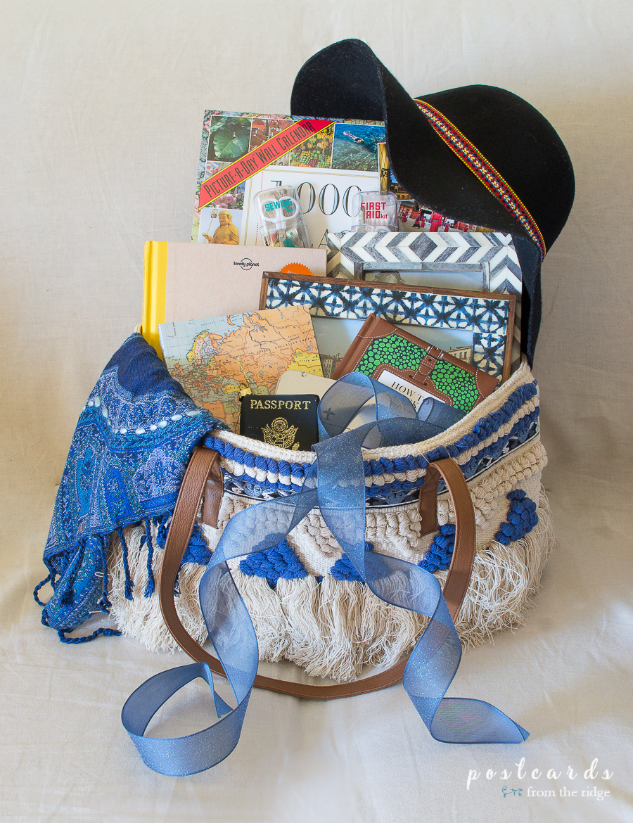 blue boho tote bag full of gifts for travelers