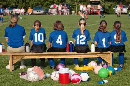 e60cd78f8 Girl soccer players on bench