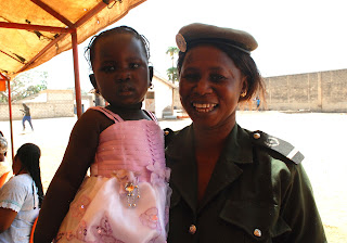 Prison Guard Beathrice Ndione and her daughter