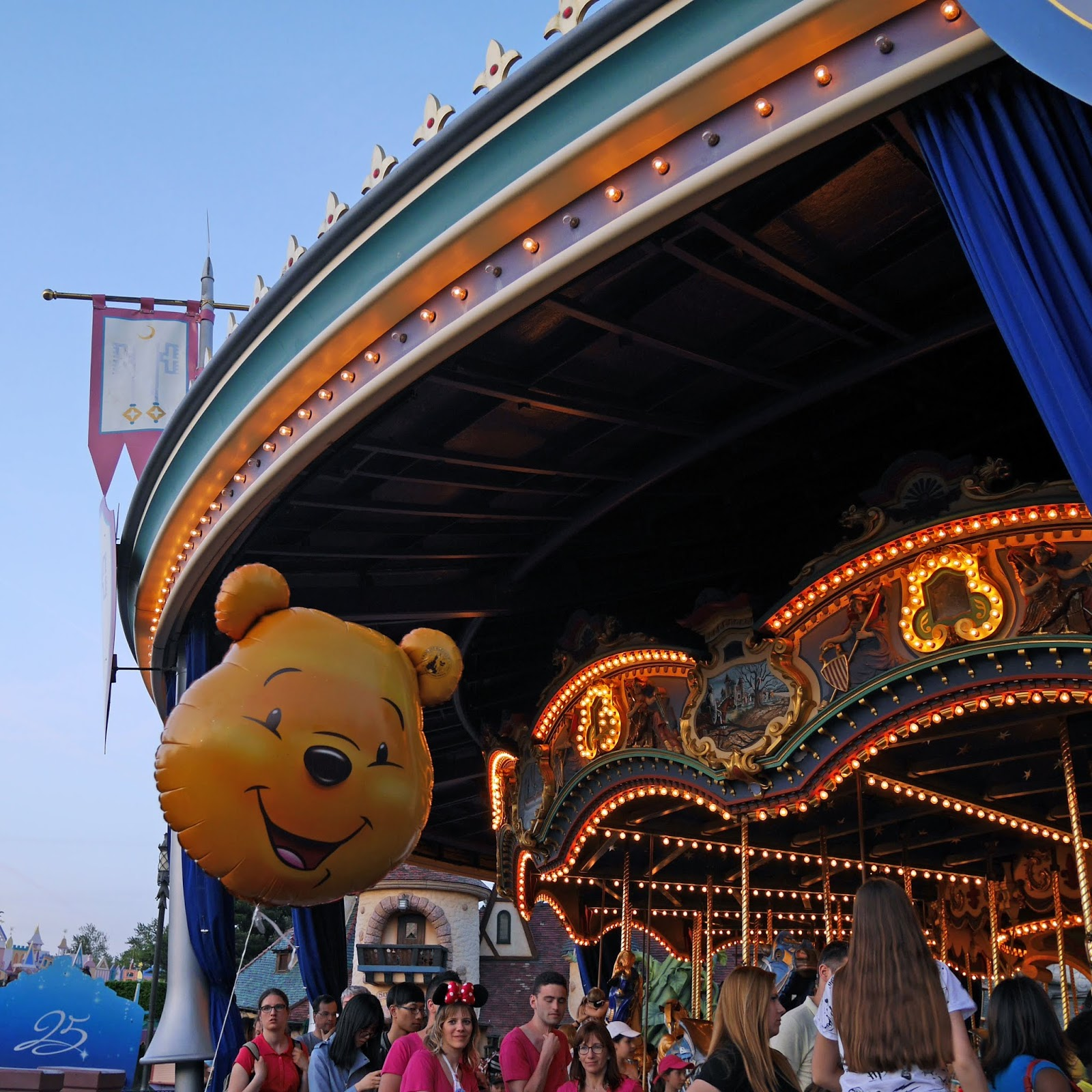 A Winnie the Pooh balloon next to the Carousel at Disneyland Paris