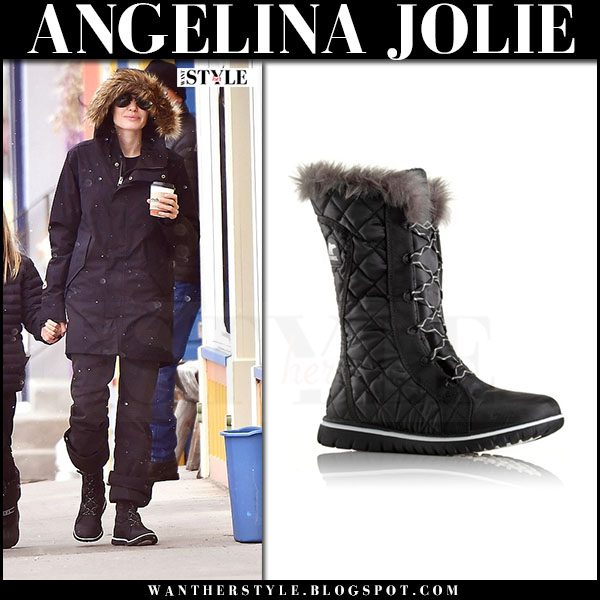 Angelina Jolie in black lace up snow boots sorel cozy cate and black parka what she wore