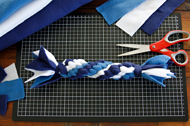 Blue and white fleece dog toy on craft table