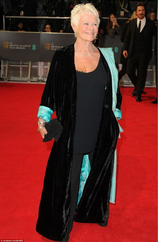 Judi Dench in a black and aqua outfit at the BAFTA 2014
