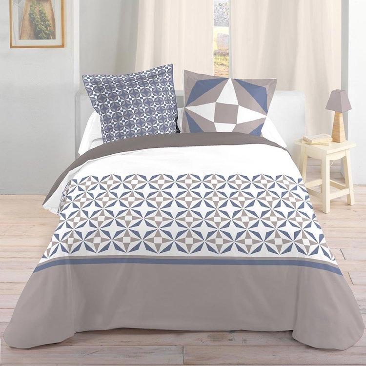 colcha gris y azul motivos geométricos