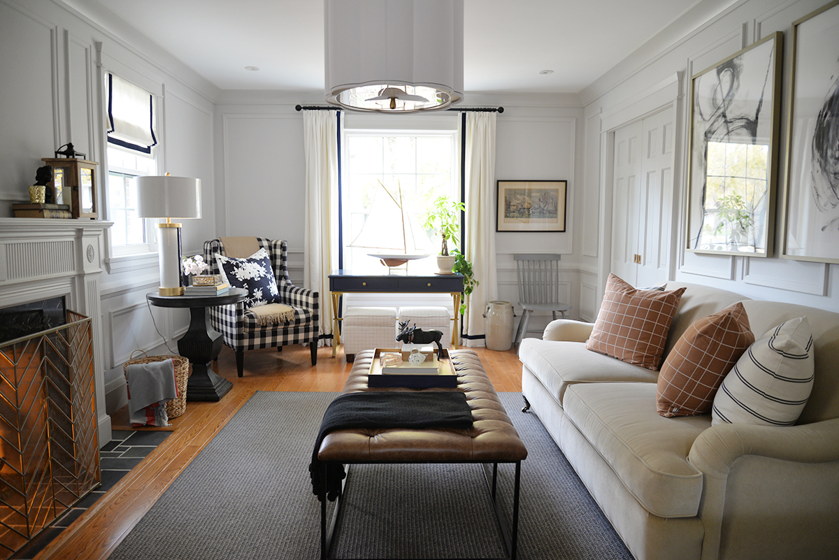 A HomePop brown tufted ottoman brings masculine cozy style to a traditional living room