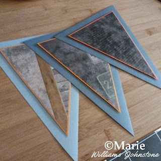 3 triangular paper flag bunting sections in grays, blacks and orange colors