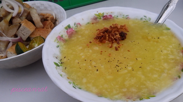 Lugaw or congee (rice porridge) commonly referred as poor man's meal. Only Php 12 and your tummy is somehow satisfied, then ask for free glass of water. Seasoned with pepper, patis (fish sauce) and kalamansi. Optional  add-on: egg, tokwa't baboy or lumpia.
