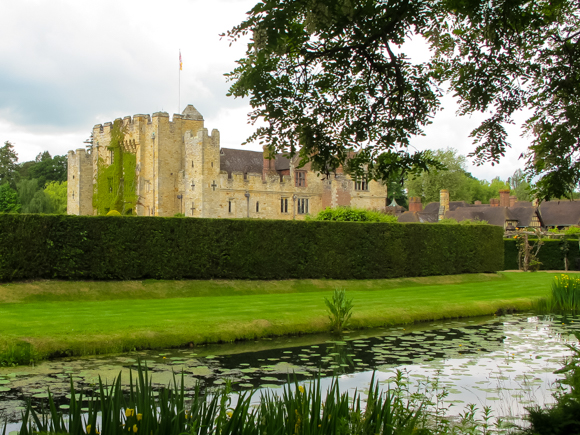 The moat around Hever Castle and the Tudor dwelling within the walls.