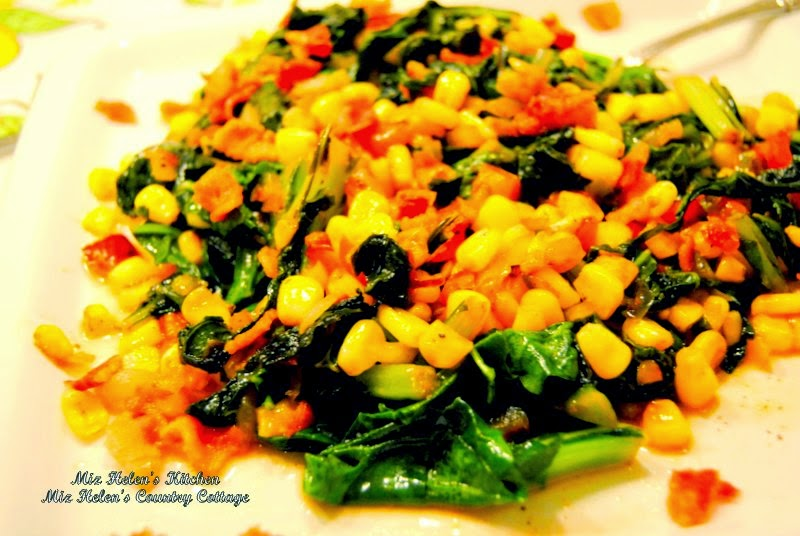 Mustard Greens and Corn Skillet with Bacon Vinaigrette at Miz Helen's Country Cottage