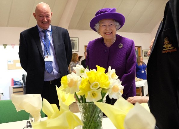 Queen Elizabeth II visited the King George VI Day Centre in Windsor. 60th anniversary of its establishment. The Queen wearing purple coat and hat
