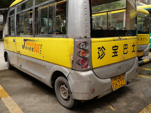 rear of a mini-mini Jumbo Wuzhou Bus