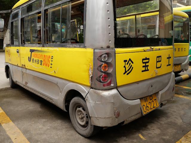rear of a mini-mini Jumbo Wuzhou Bus