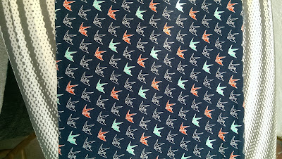 Quilting cotton with paper crane motif
