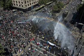 Chileans go on strike as protest death toll hits 18