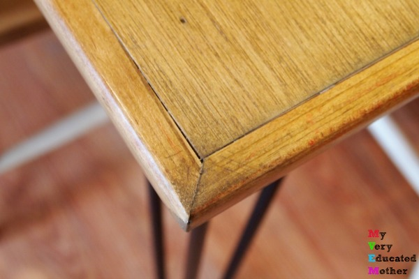 Use cheap baseboard to cover the rough edges of your pallet wood dining table, plus check out those hairpin legs!
