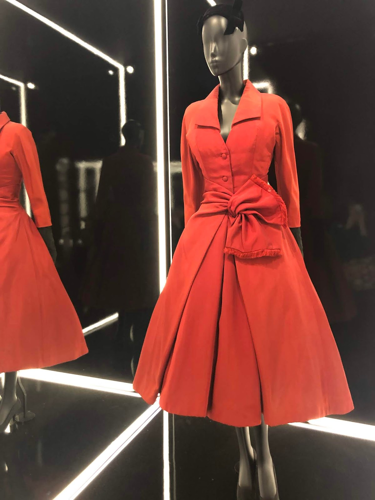 christian dior exhibition v and a red dress