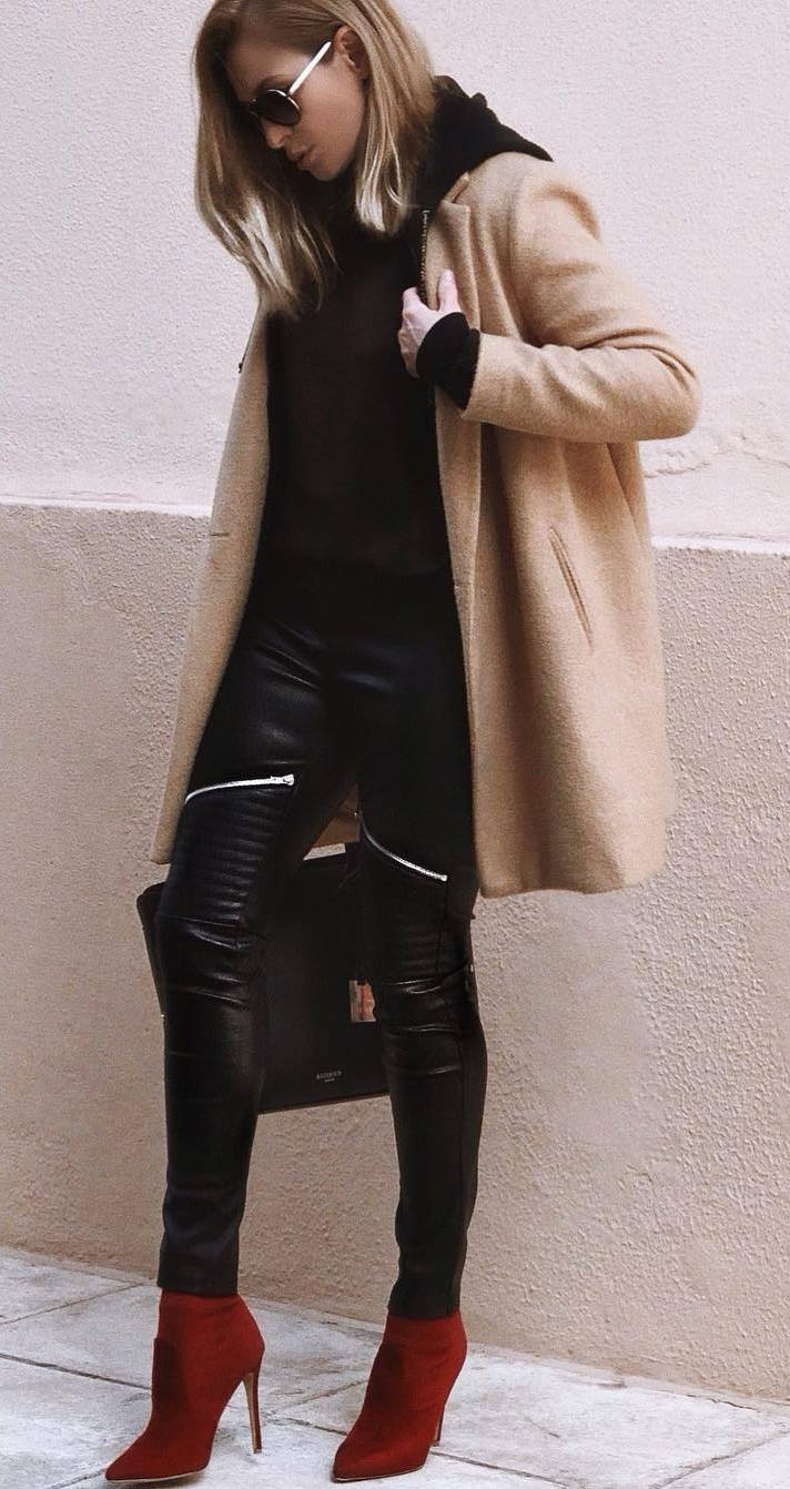 best fall outfit / nude coat + black top + leather pants + red boots + bag