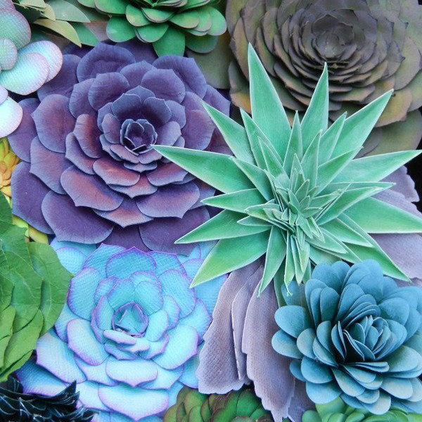 hand cut and sculpted paper succulents in greens, blues, and purples