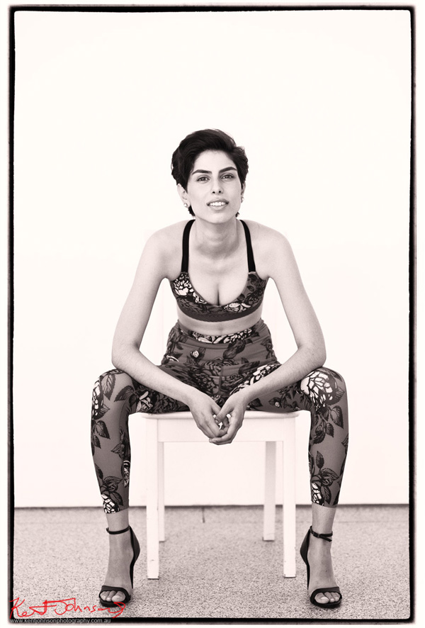 Black and white photograph of Teo seated in activewear - from the first look, first frames of her first photoshoot.  Photographed in Sydney by Kent Johnson