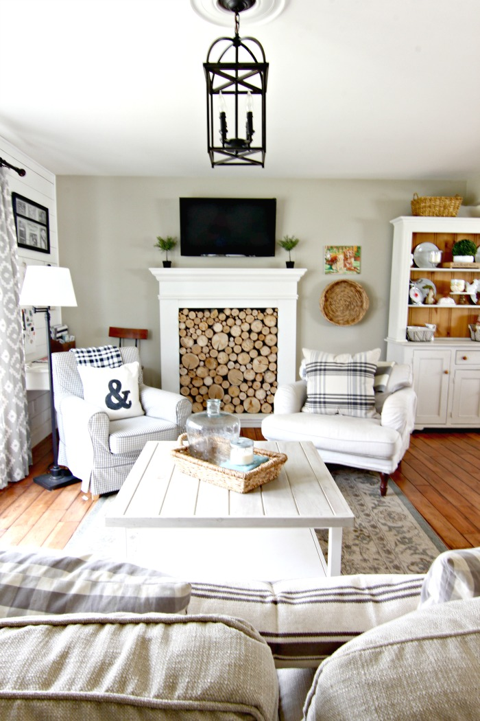 Lantern light with faux fireplace in living room - www.goldenboysandme.com