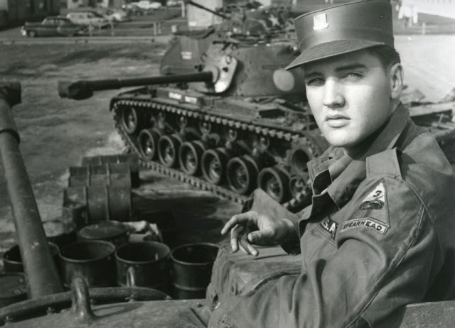Image: Elvis Presley poses for the camera during his military service at a US base in Germany, by Vittoriano Rastelli on Wikipedia