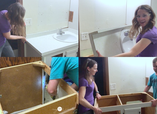 Removing the old vanity in the bathroom