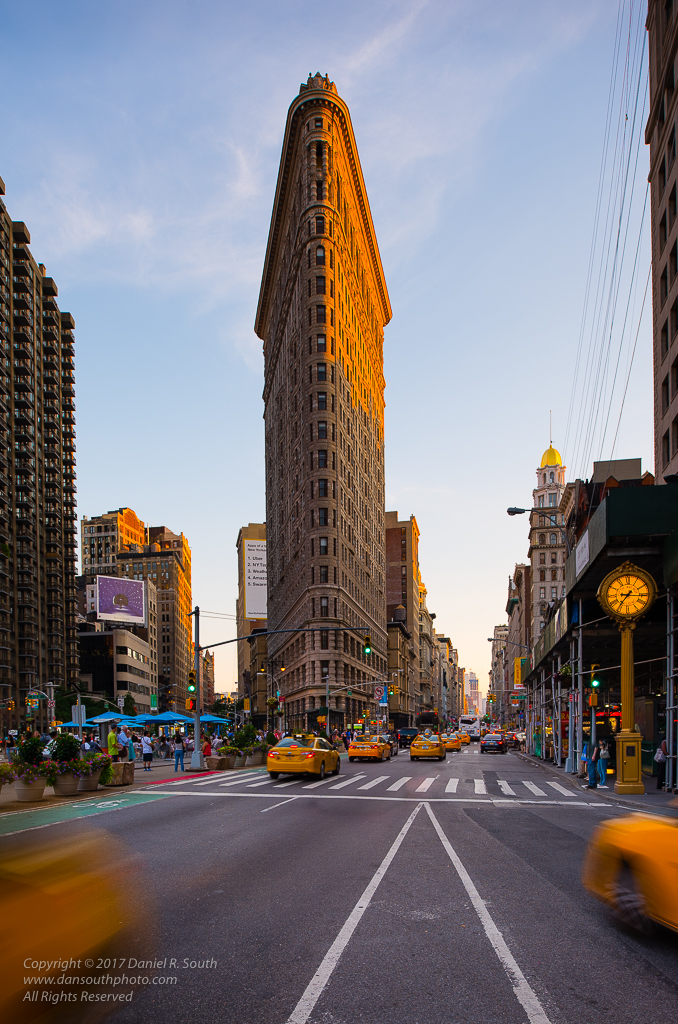 a photo of the flatiron building in new york at sunset
