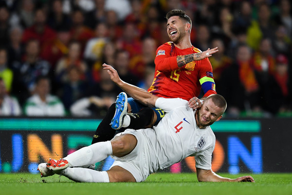 Sergio Ramos of Spain is challenged by Eric Dier of England during the UEFA Nations League A group four match between Spain and England at Estadio Benito Villamarin on October 15, 2018 in Seville, Spain