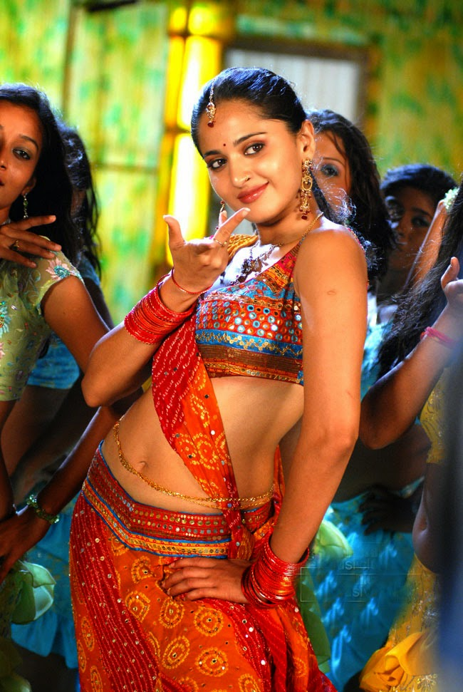 Anushka Shetty Hot Hip Navel Show Photos In Orange Top Lehenga