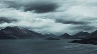 beach black and white clouds