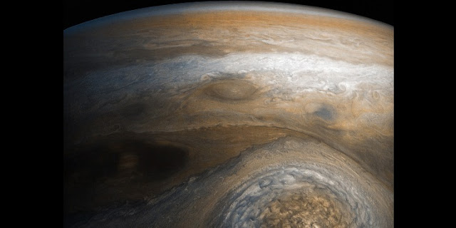 A dynamic storm at the southern edge of Jupiter's northern polar region dominates this Jovian cloudscape, courtesy of NASA's Juno spacecraft. Image credits: NASA/JPL Caltech/SwRI/MSSS/Gerald Eichstädt/Seán Doran