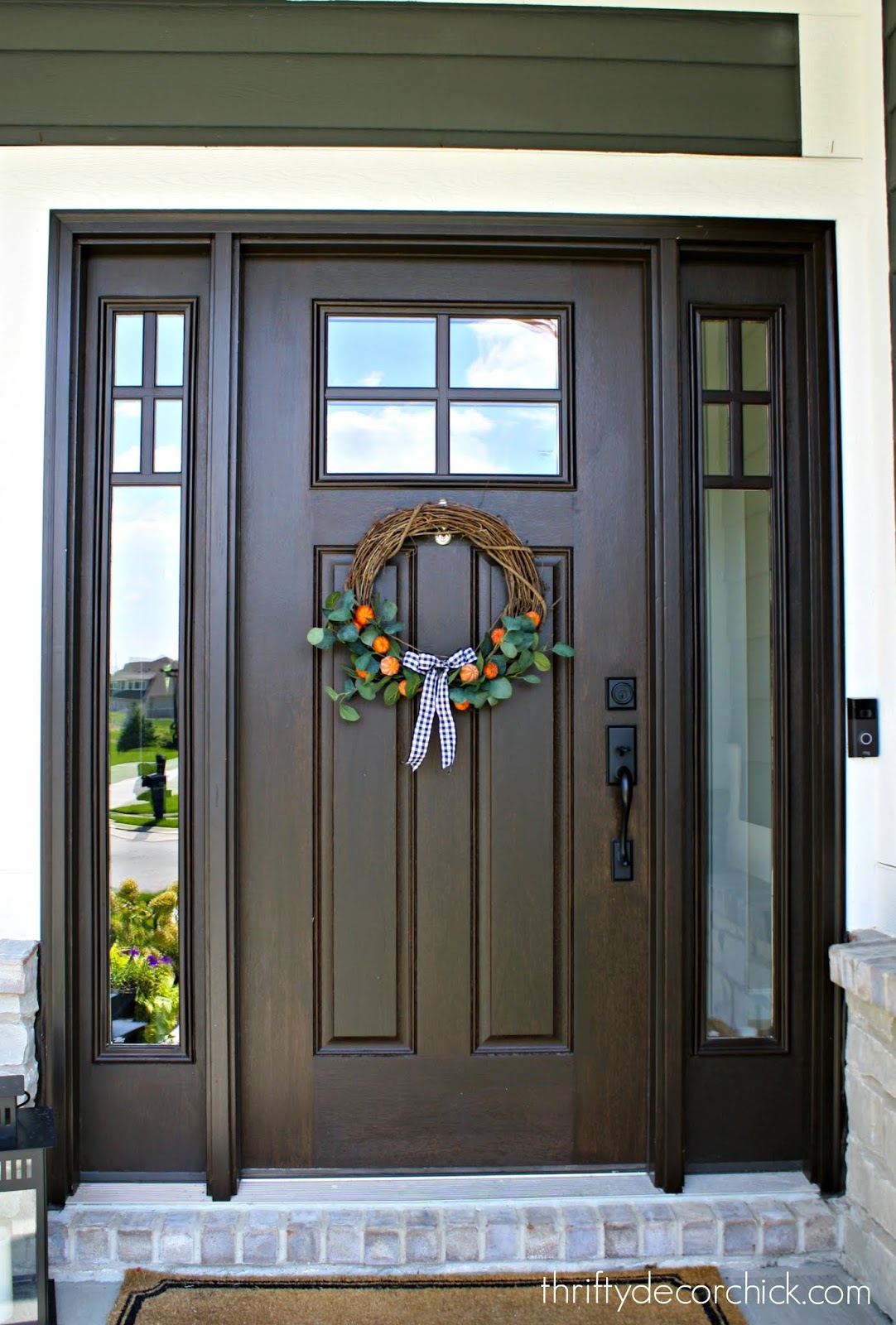 Craftsman stained door with windows and sidelights