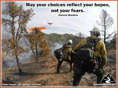 May your choices reflect your hopes, not your fears. – Nelson Mandela  Wildland firefighters on a ridge watching an airtanker drop