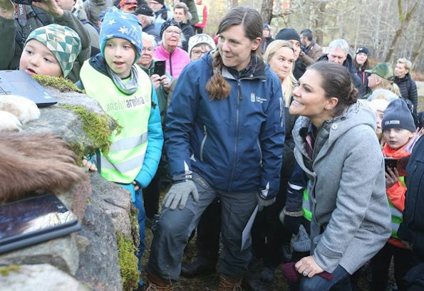 Crown Princess Victoria hiking of 2017 in Glaskogen Nature Reserve Värmland. Victoria wore wool coat fashion